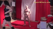 Nasty MILF gives backstage blowjob to guy